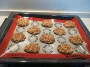 Why Use Silicone Baking Mat - a baking tray with oatmeal cookies.