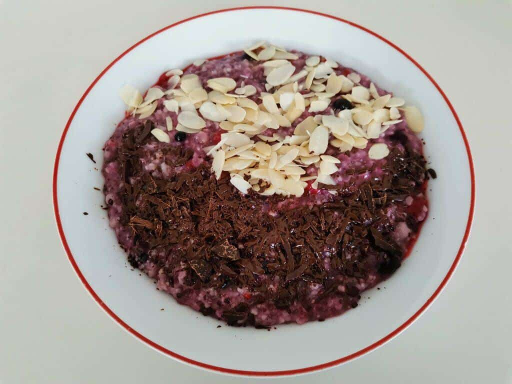frozen berries oatmeal with additional chocolate toppings