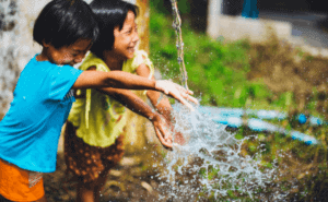 water playing in the backyard - one of the most common summer staycation ideas for families with toddlers.