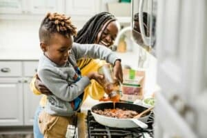 A mom with her kid preparing kid-friendly make-ahead meals