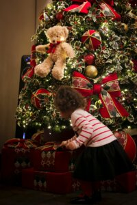 a kid about to get one of her non-toy gifts.